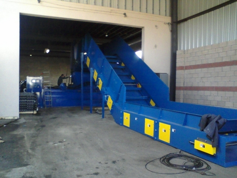 above_ground_conveyor_and_2_ram_baler-1