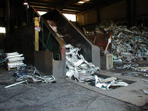 aluminum_sheets_fed_into_baler-1